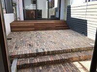 White mahogany decking with sandstock bricks in Newtown