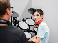 Boy learning drums